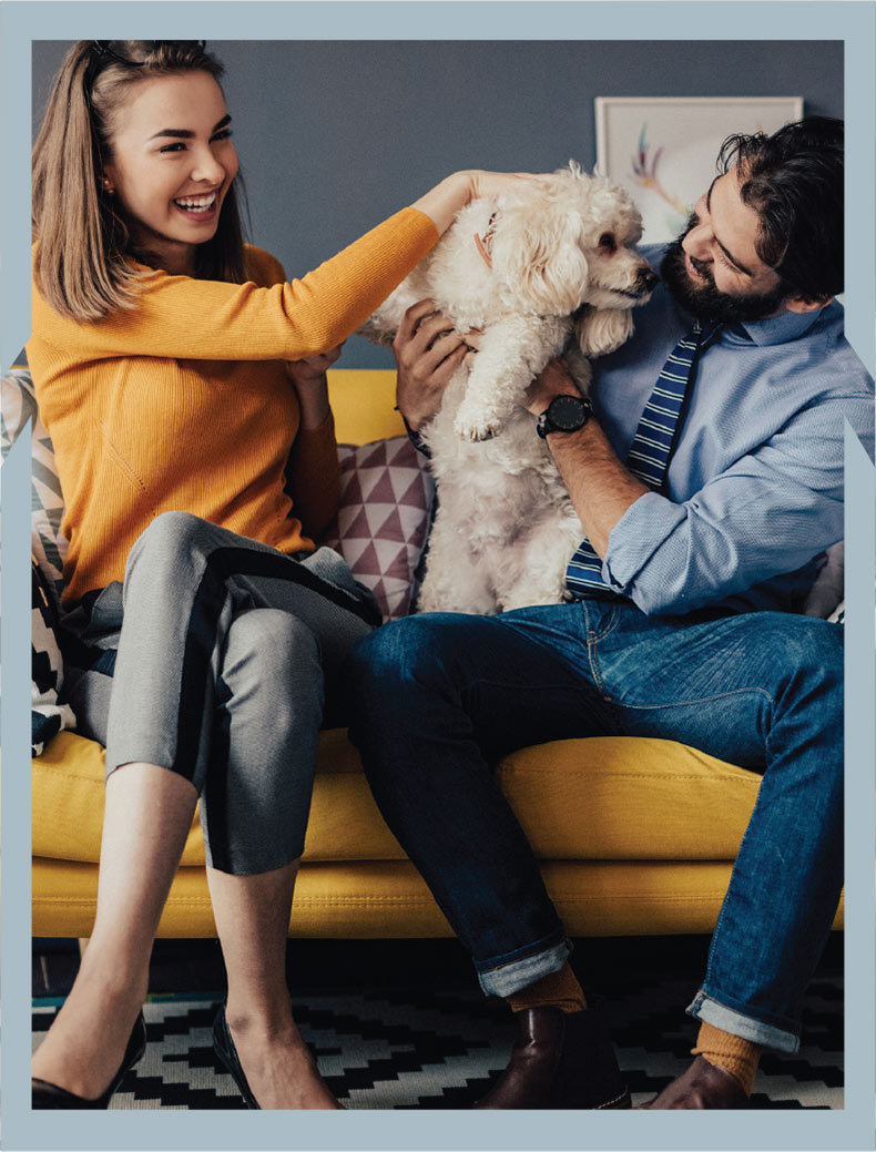Young woman and man petting their dog